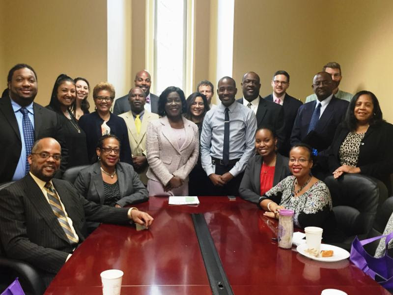 Image:People's Counsel Sandra Mattavous-Frye with OPC and DC Council staff.